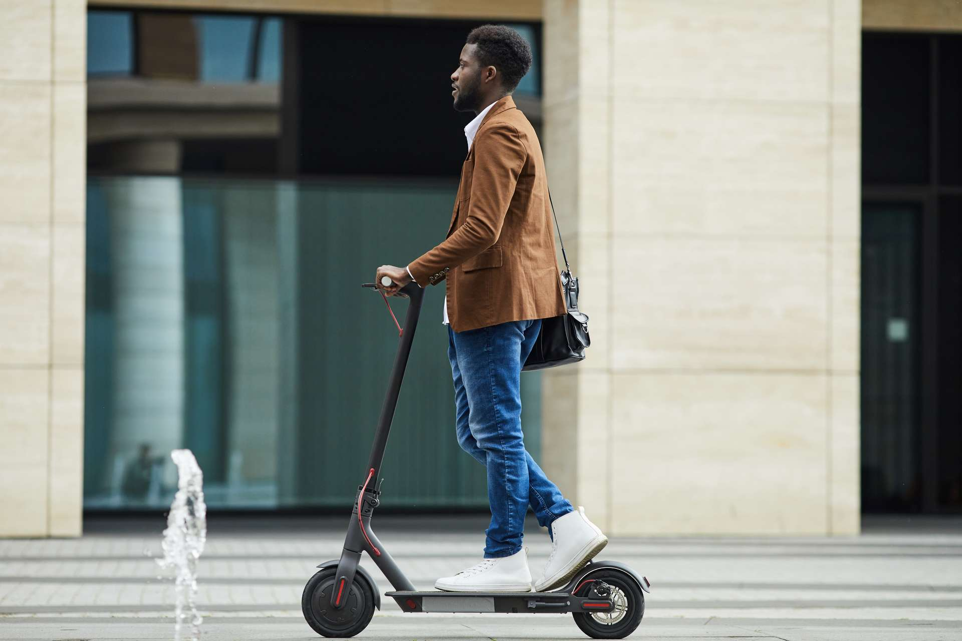 African Man Riding Electric Scooter Background